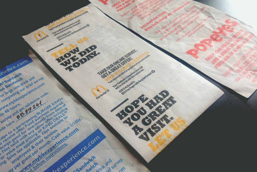 Survey offers printed on the back of fast food restaurant surveys.